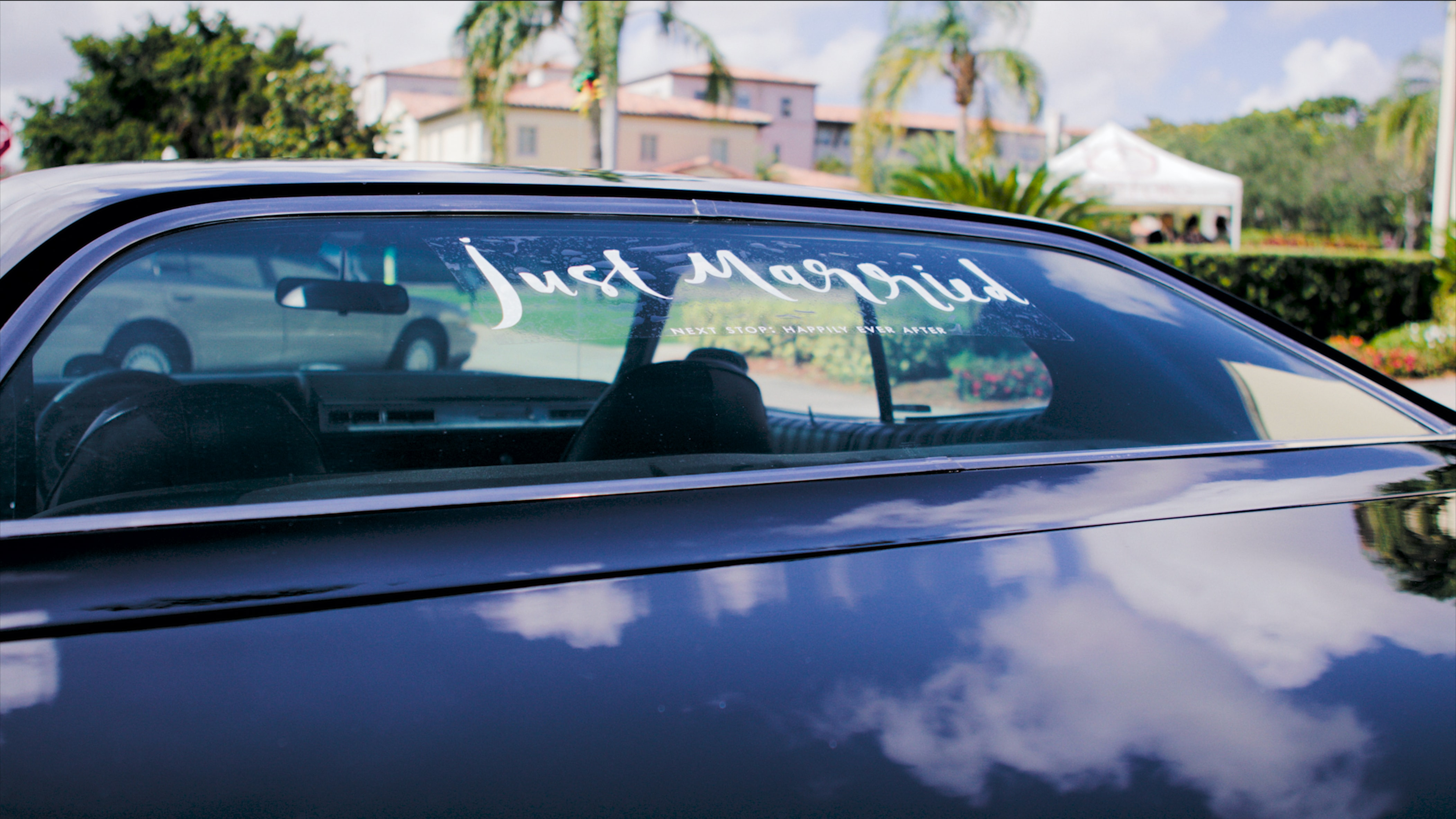 just married banner on a limousine