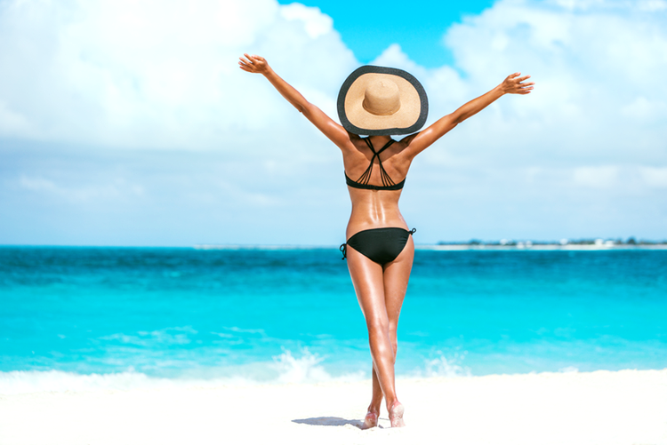 Get freedom from body hair with laser hair removal in Mumbai - happy woman on the beach
