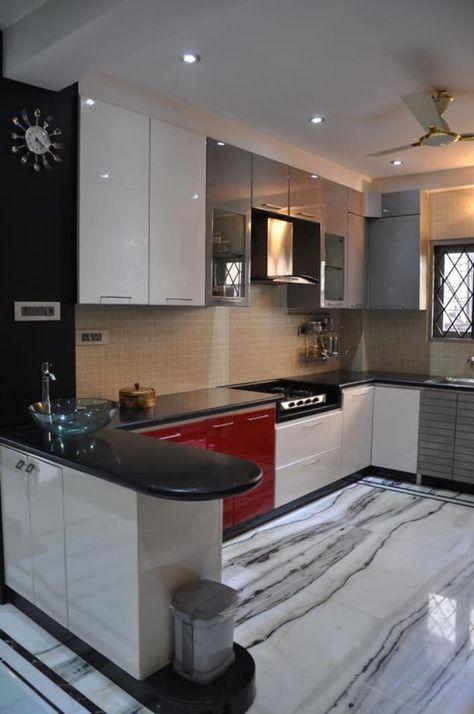 U shaped kitchen with modern cabinets and wall decor by Prashant Mali.jpg
